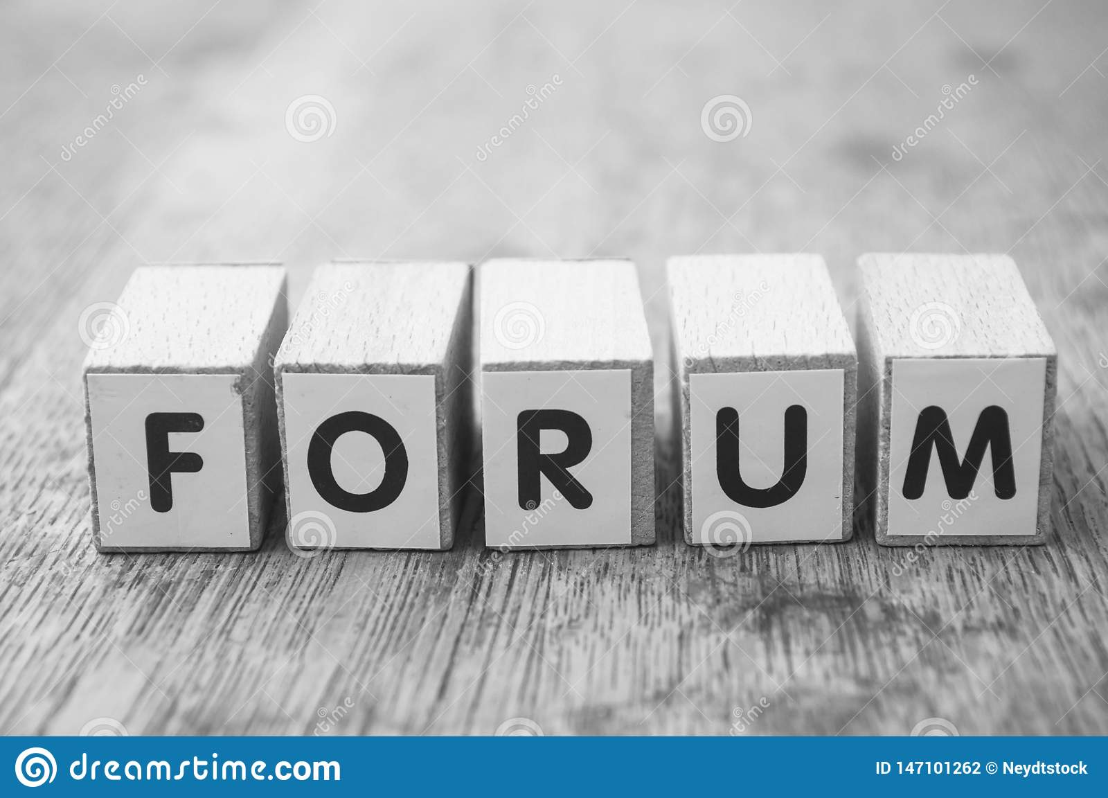 word on wooden cube on wooden desk background concept - Forum