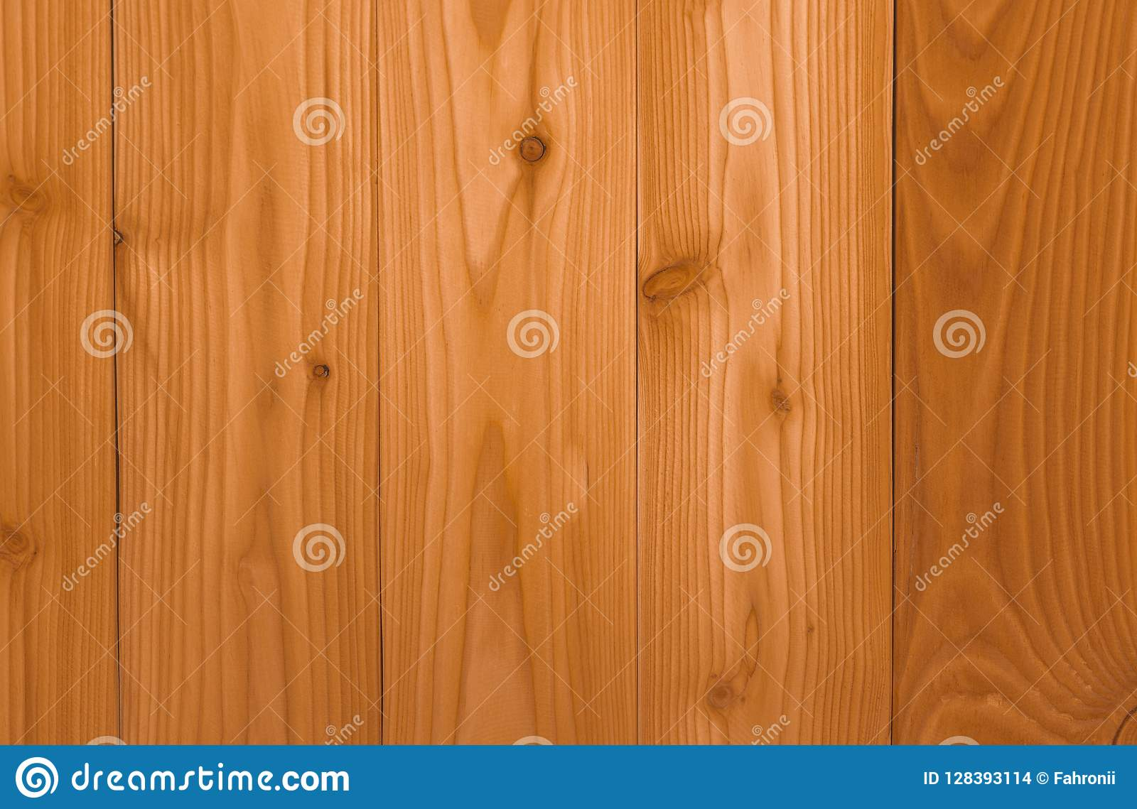 Closeup yellow wood texture background. Wood texture with unique pattern.Empty brown wooden wall. Wooden board. Orange wood timber