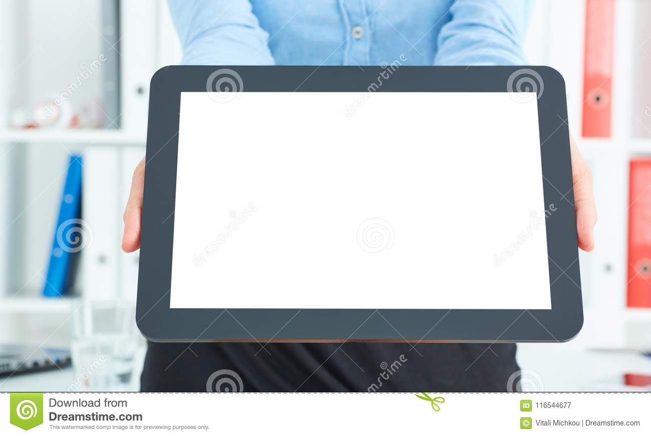 Closeup of a young businesswoman offering to you a brand new pad with blank screen.