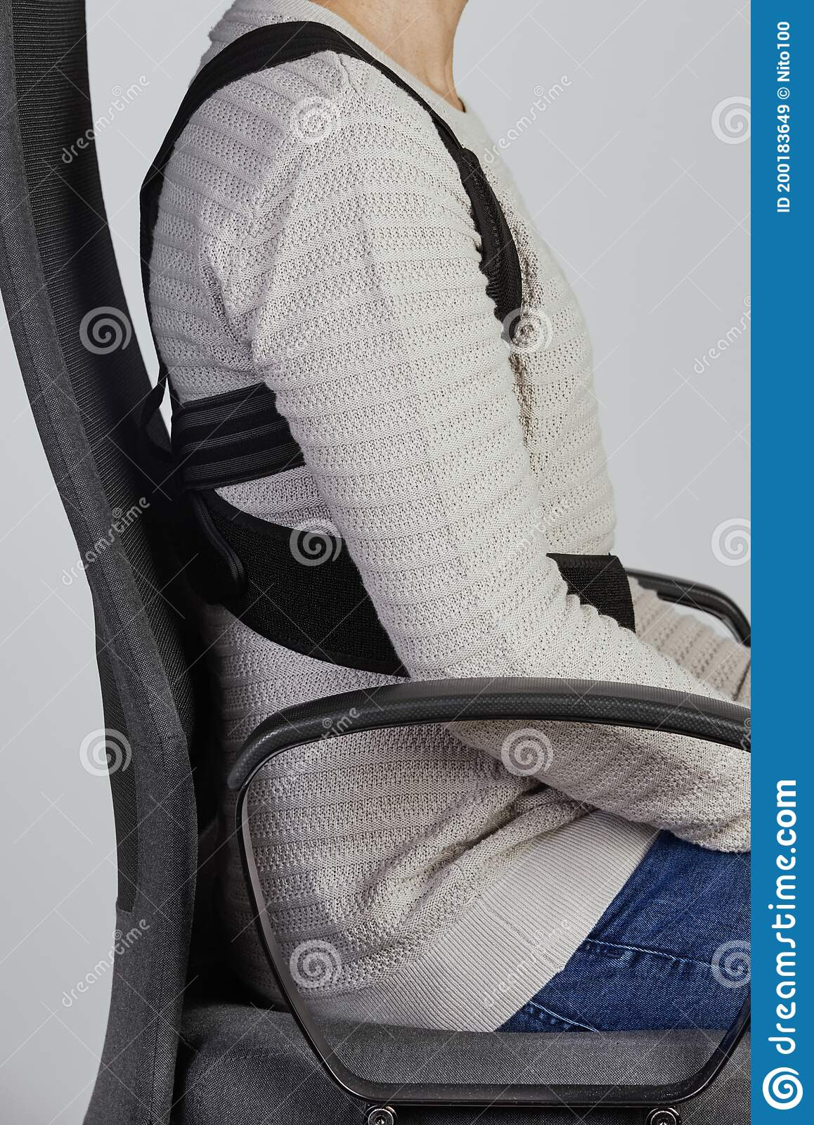Man Wearing A Posture Corrector While Sitting Stock Image Image Of Chair Healthcare 200183649
