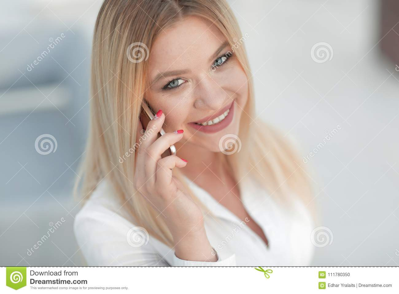 Closeup of young woman talking on a mobile phone.