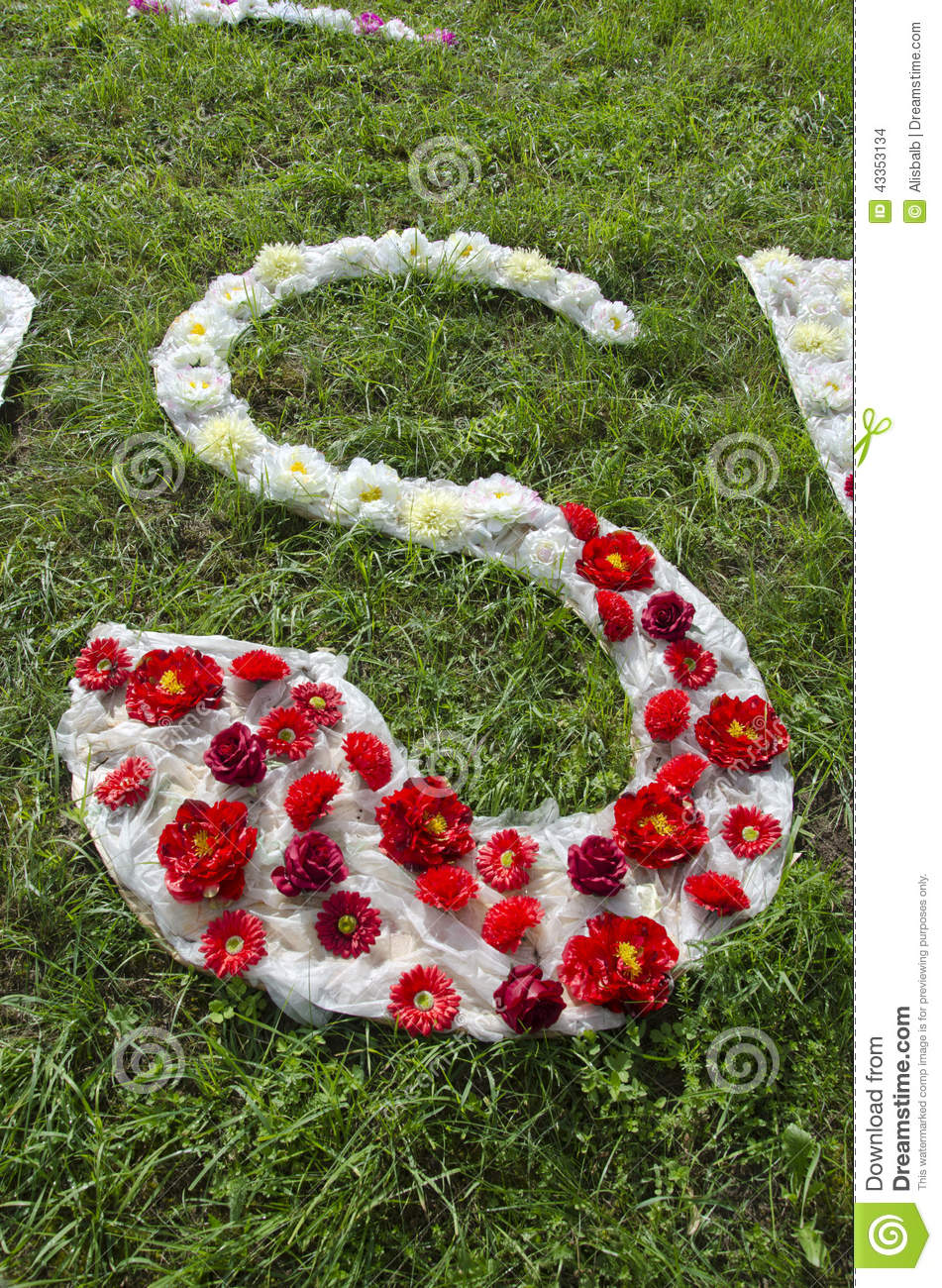 Cloth And Flower Alphabet Letter S On Grass In Park Stock Photo