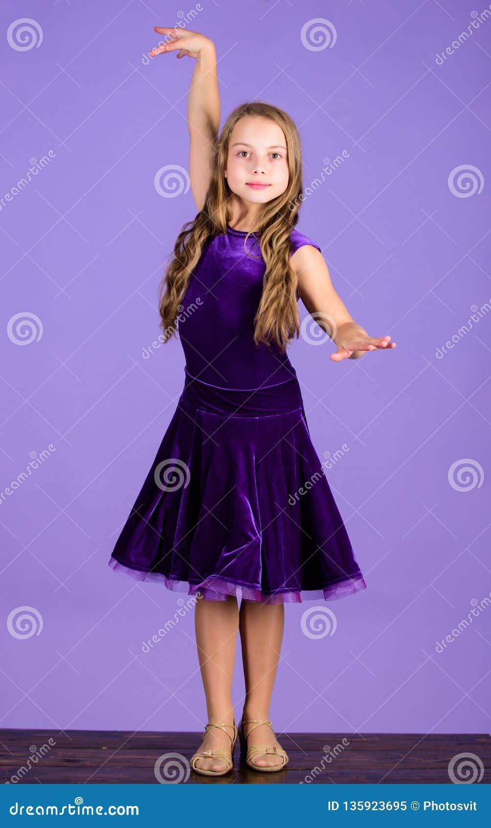 Clothes for ballroom dance. Kids fashion. Kid fashionable dress looks adorable. Ballroom dancewear fashion concept. Kid