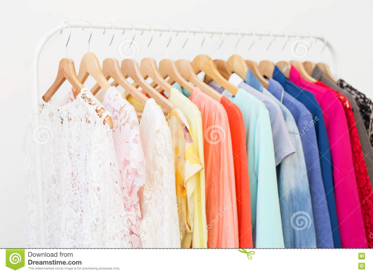 Download Clothes In The Closet Hanging On Hangers Stock Photo   Image Of  Clothing, Blue