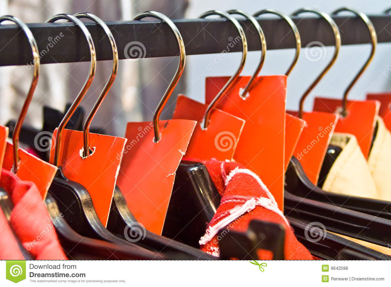 Clothes Hangers With Sale Red Labels In A Shop Royalty