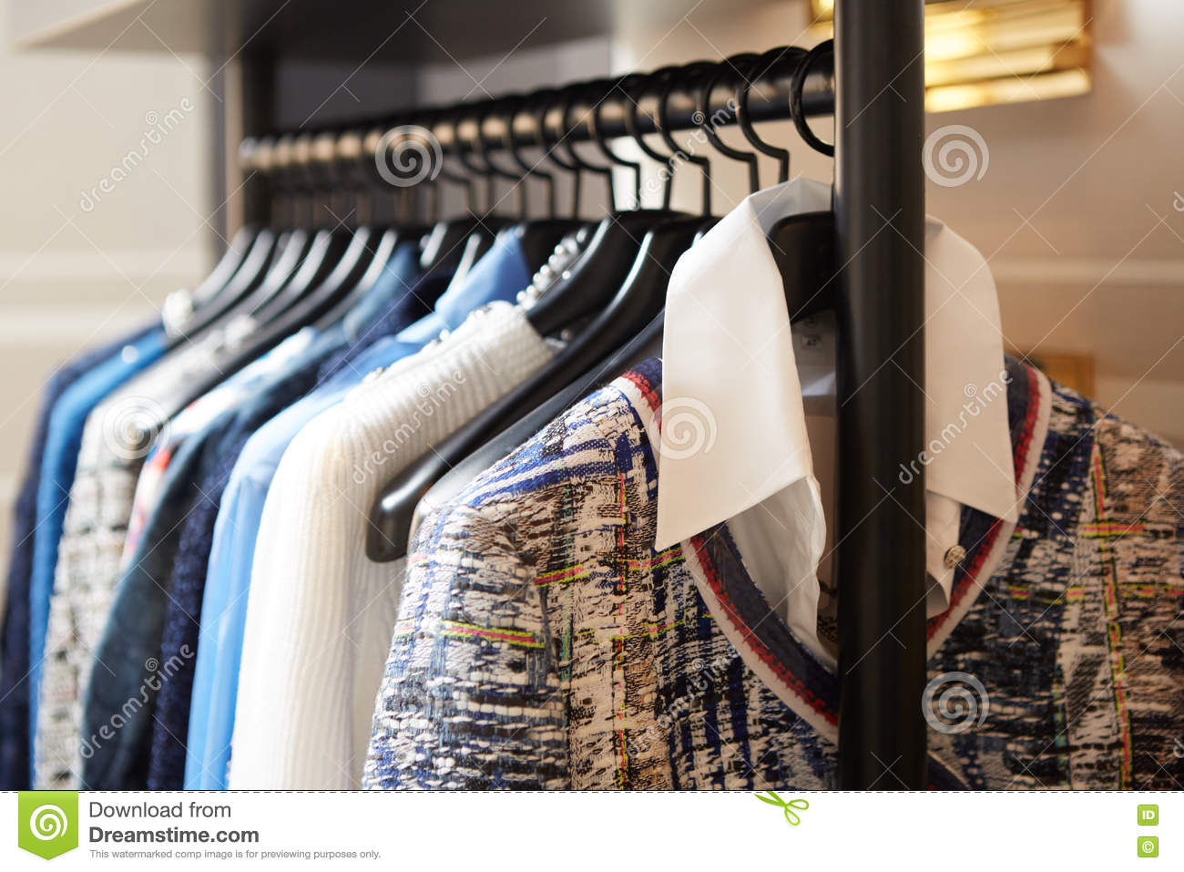 clothes on hangers in shop royalty free stock photo 70047417. Black Bedroom Furniture Sets. Home Design Ideas