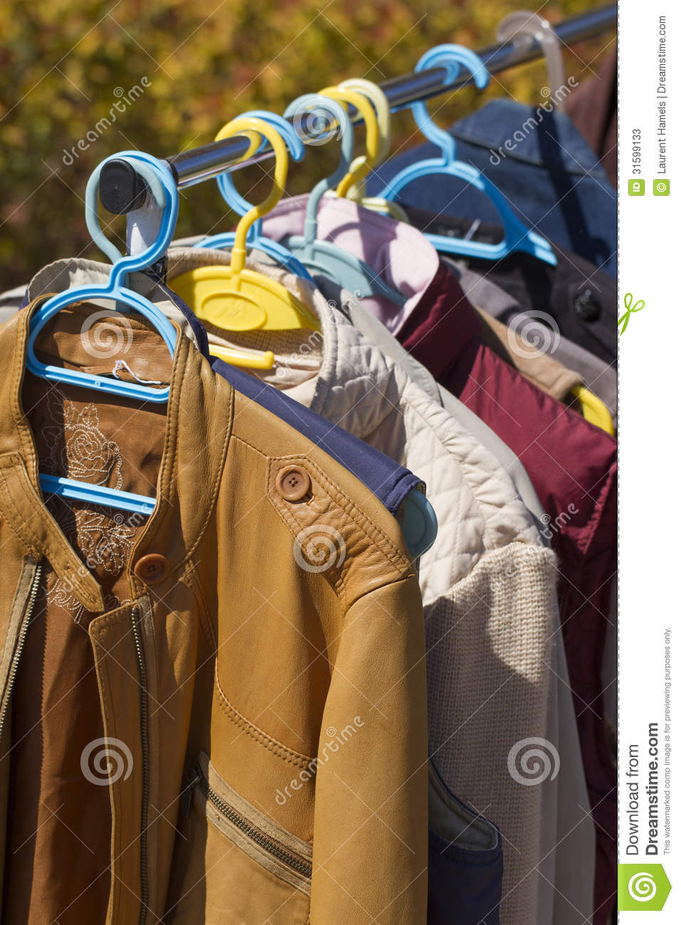 Clothes And Leather Jacket Displayed At Garage Sale Stock
