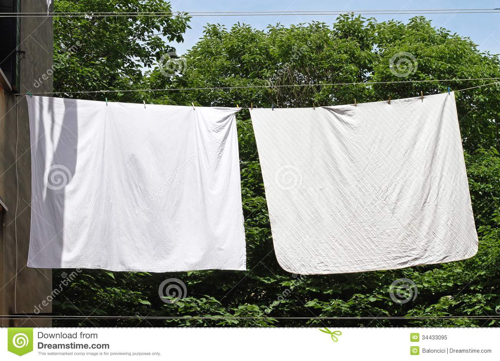 Bed sheet hanging - Royalty Free Stock Photo