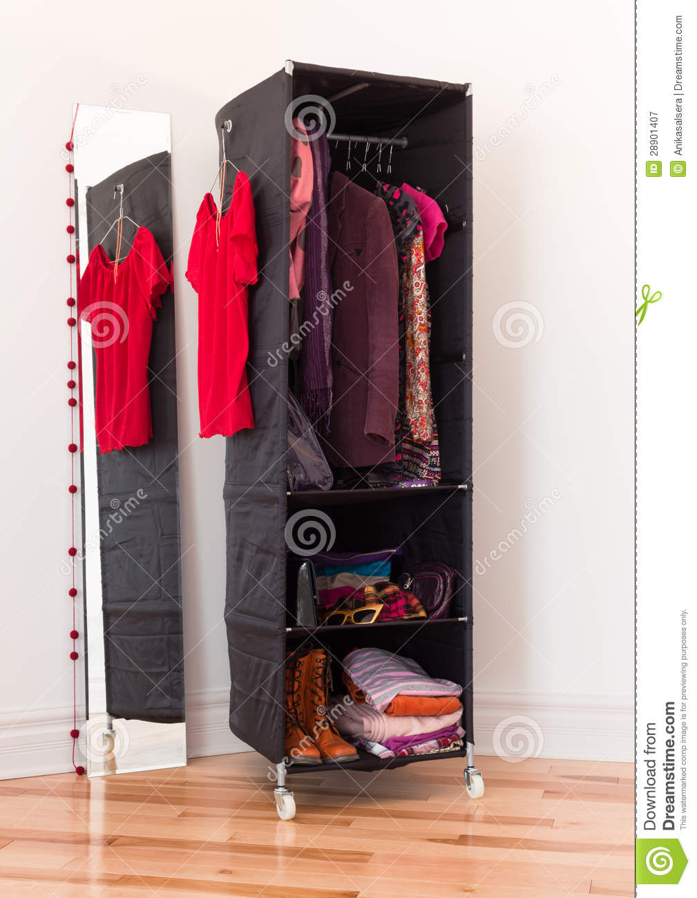 Clothes Organizer With Clothing And Accessories Stock