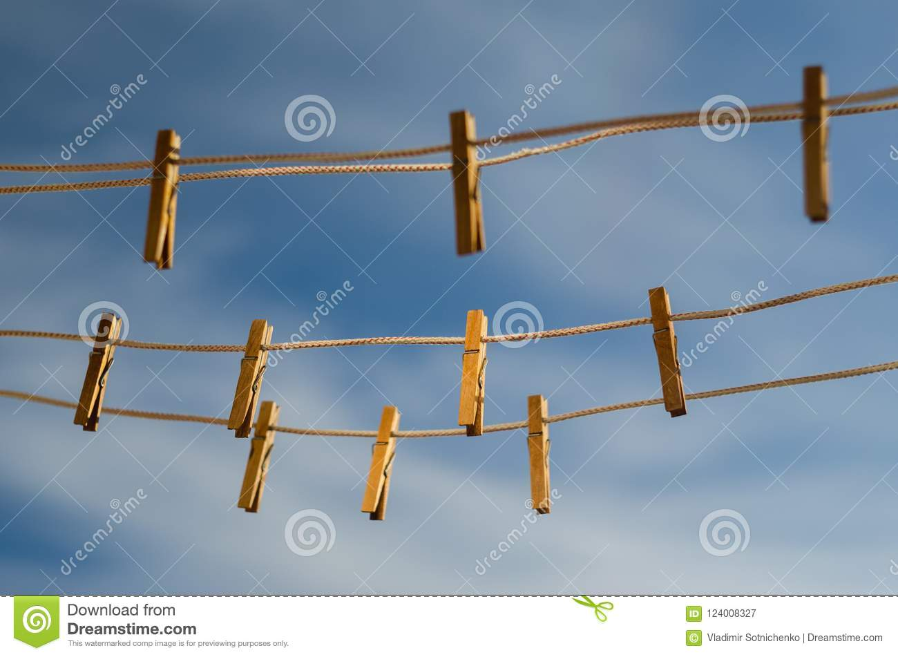 Clothespins On A Clothesline Against A Blue Sky Stock ...