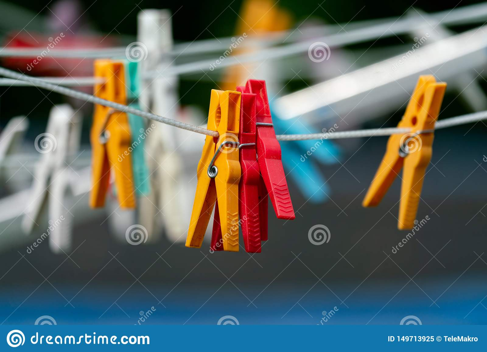 Red and yellow clothespins on washing line
