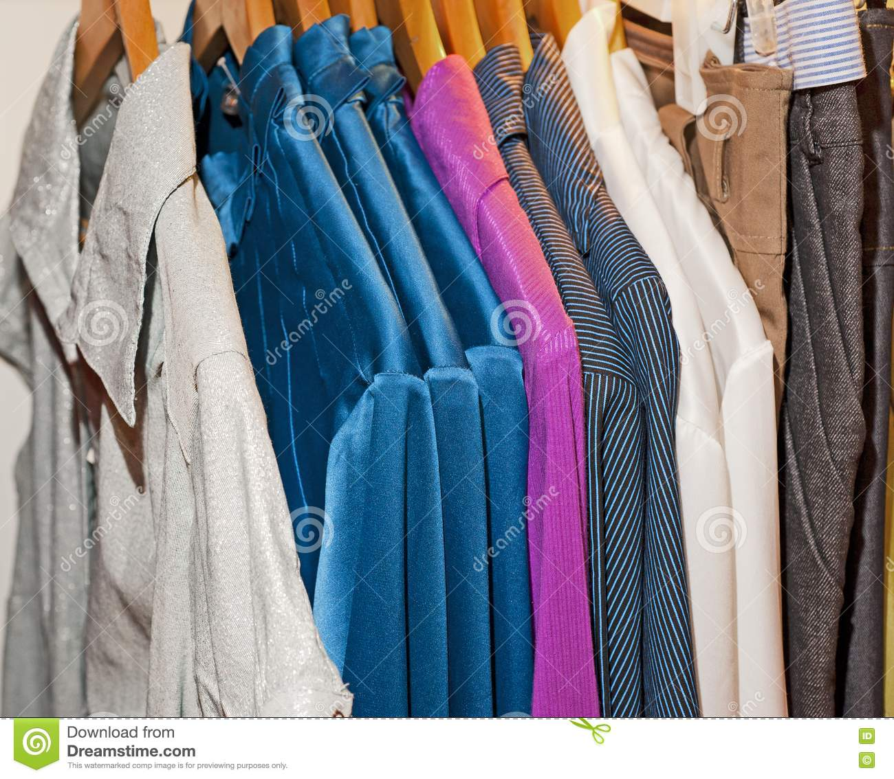 Clothing Hanging On A Rail Royalty Free Stock Photos - Image 14835808