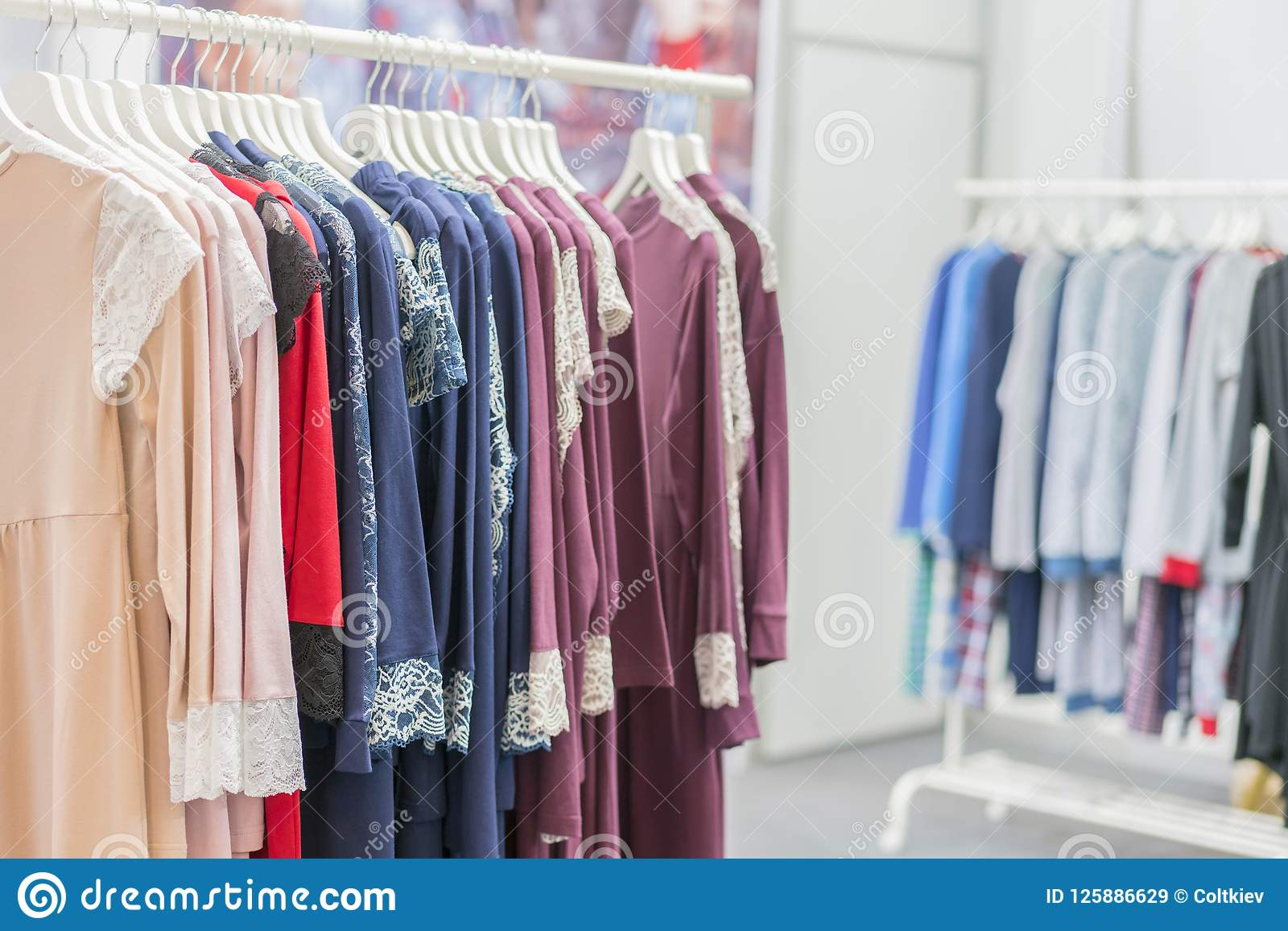 d35a48aced Clothing retails concept. Ladies pajamas on hangers in clothes store.  Pajama in shop.