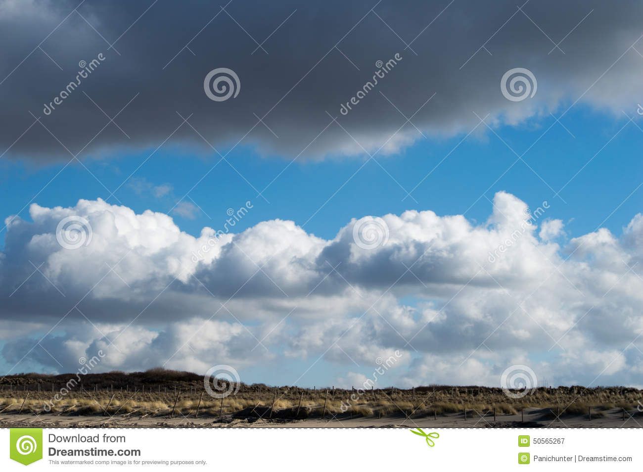 Clouds in a beautiful cloud formation above the dunes
