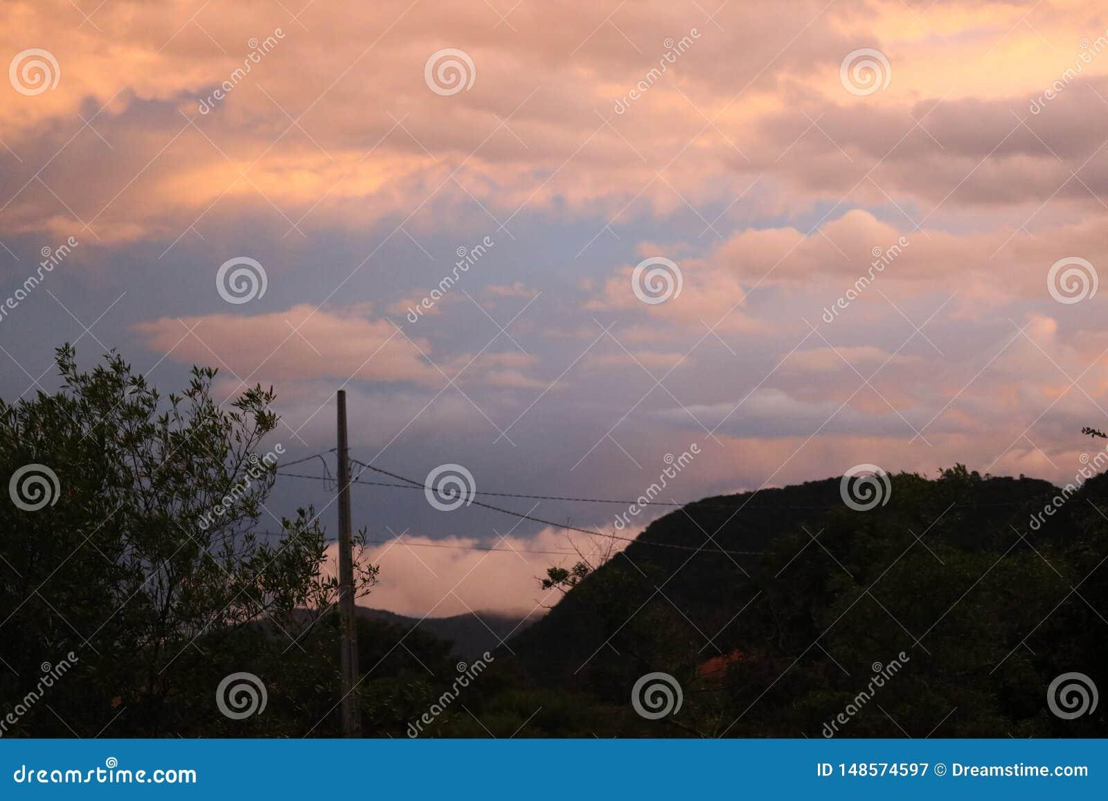 Clouds on mountain city sunset beach