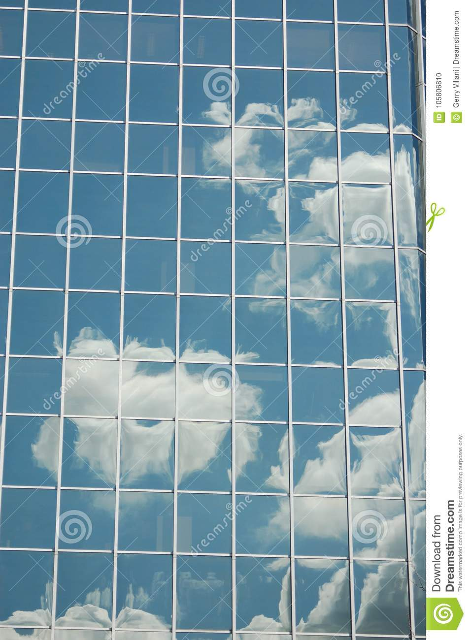Clouds reflected in an office building`s window, Portland, Oregon