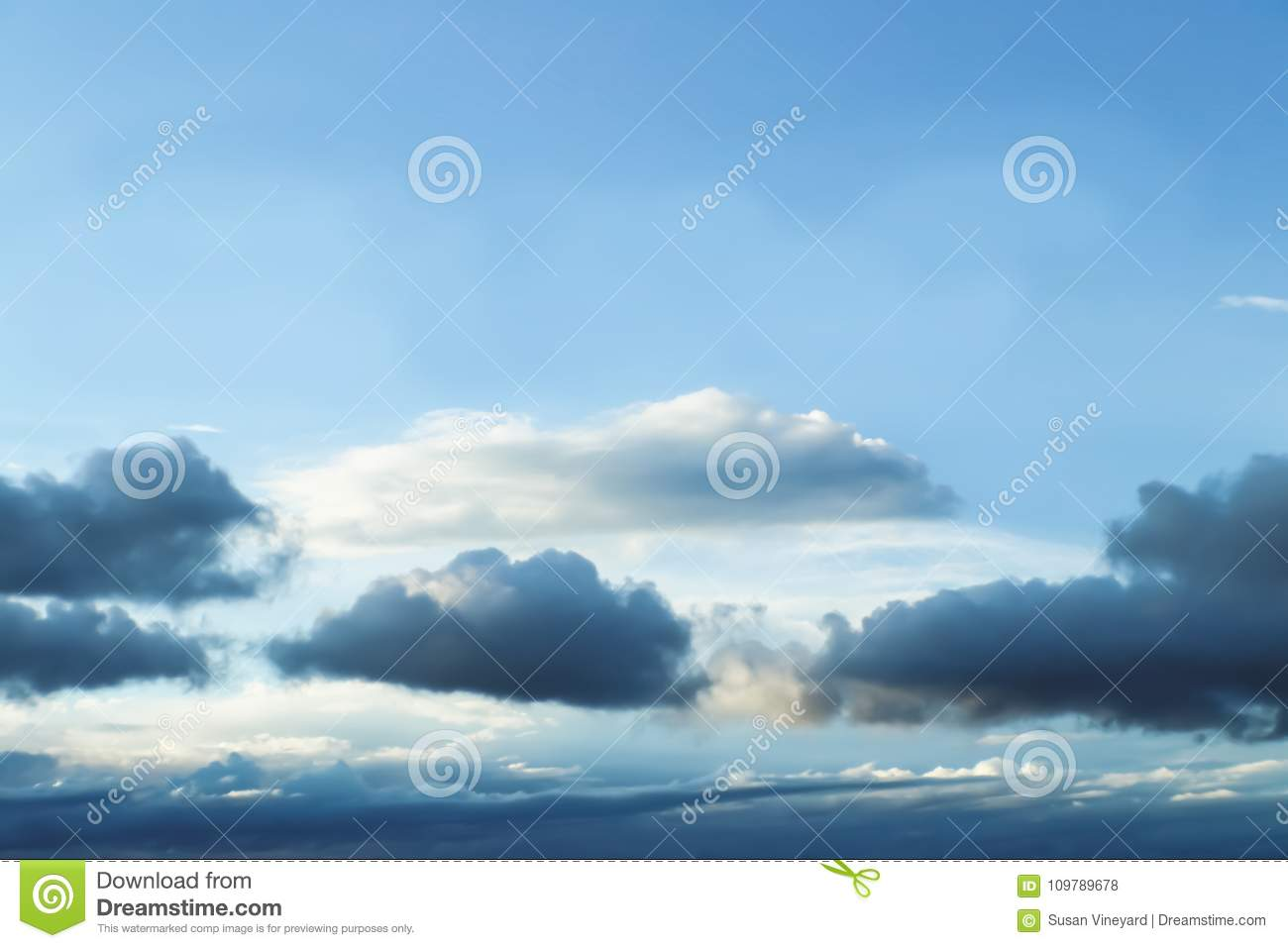 Cloudscape - Blue sky with layers of clouds near the bottom as a storm forms - no land - background or room for text