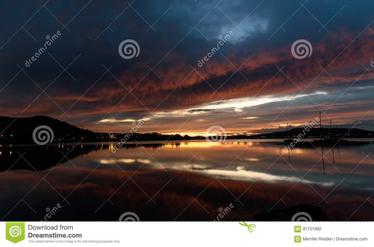 Cloudy Dawn Waterscape on the Bay with Reflections