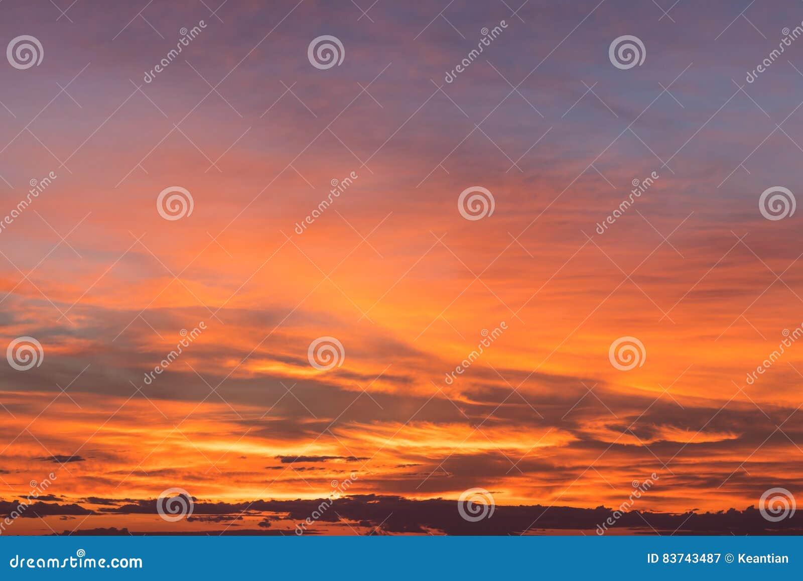 Cloudy sky orange yellow.