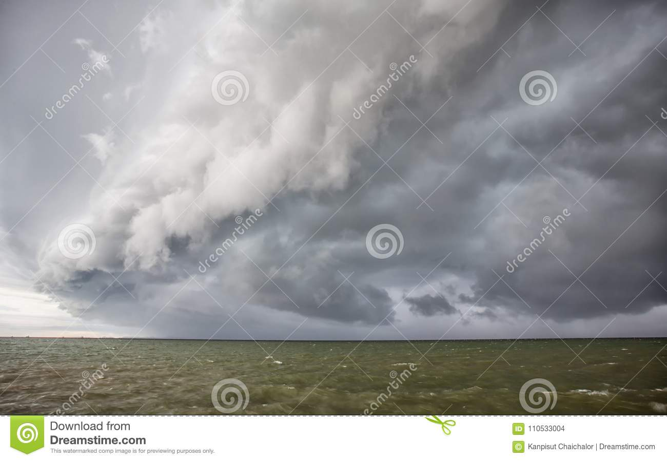 Cloudy storm in the sea before rainy. Tornado storms cloud above the sea.