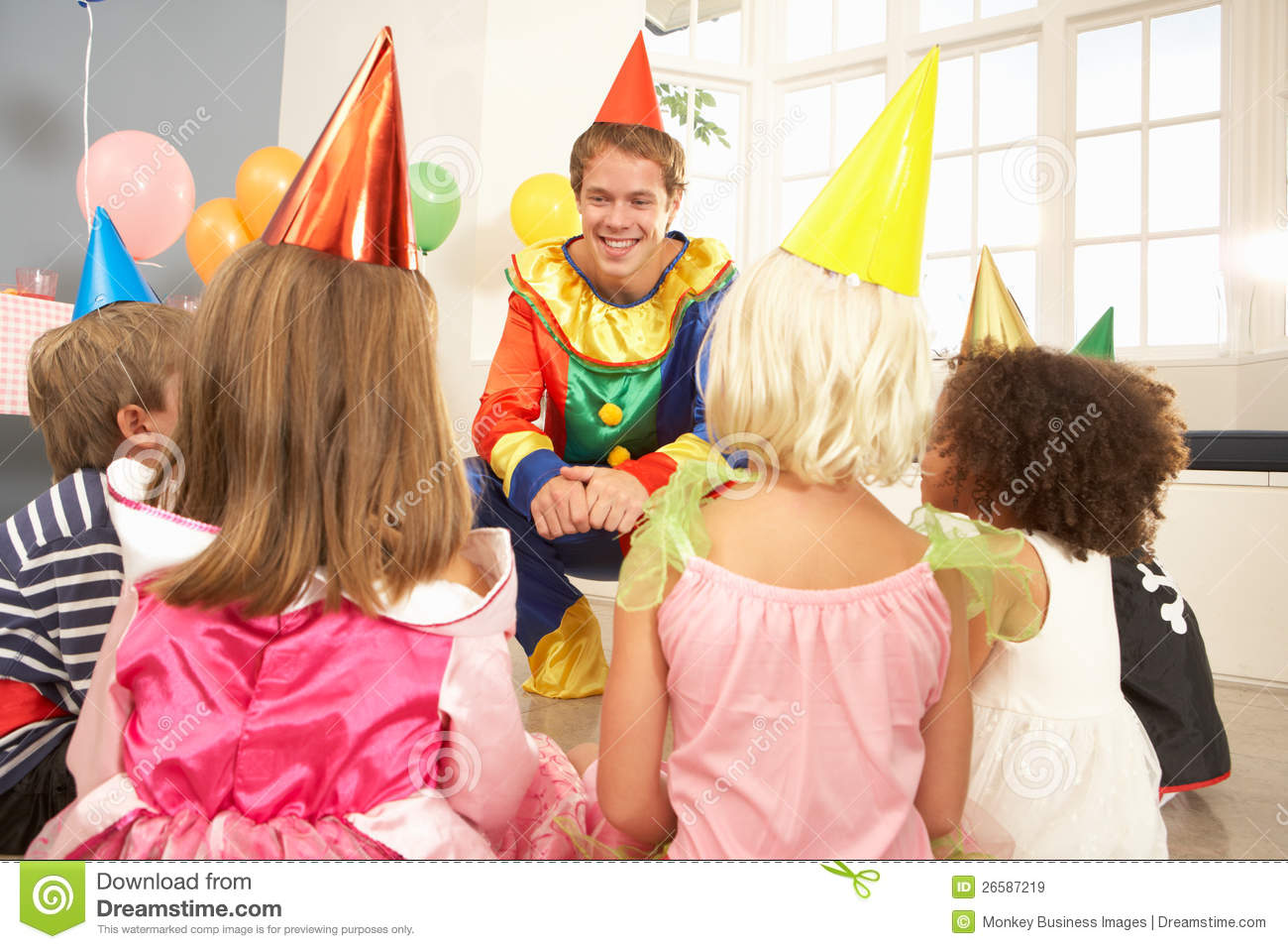 clown entertaining children at party royalty free stock