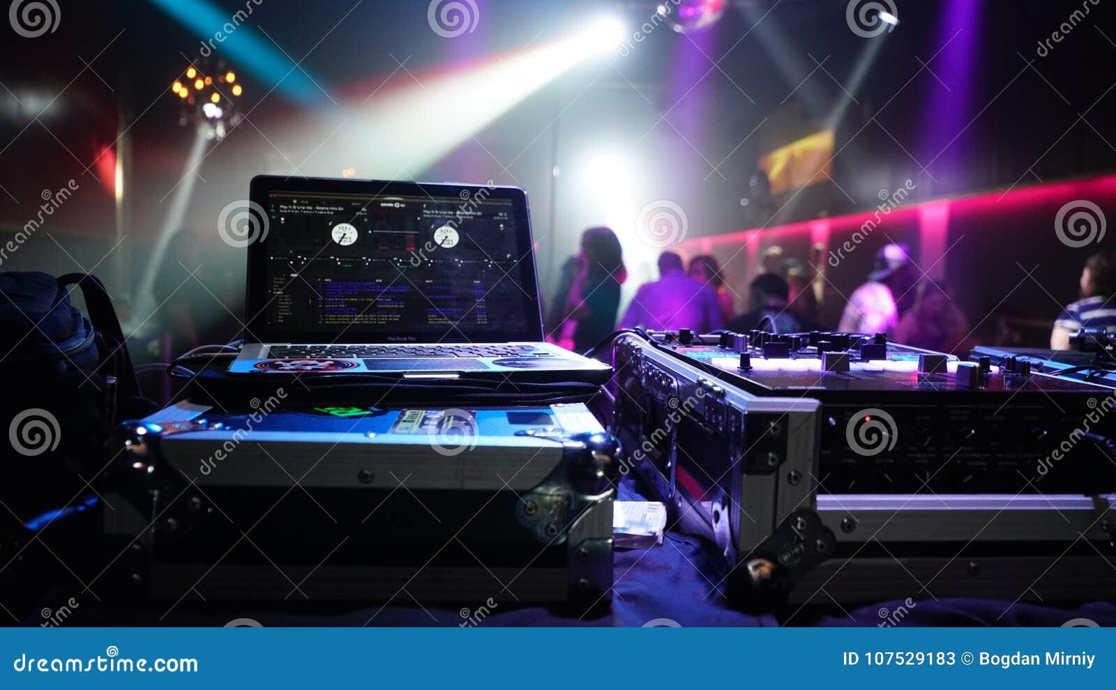DJ Playing Music In A Night Club Editorial Stock Photo