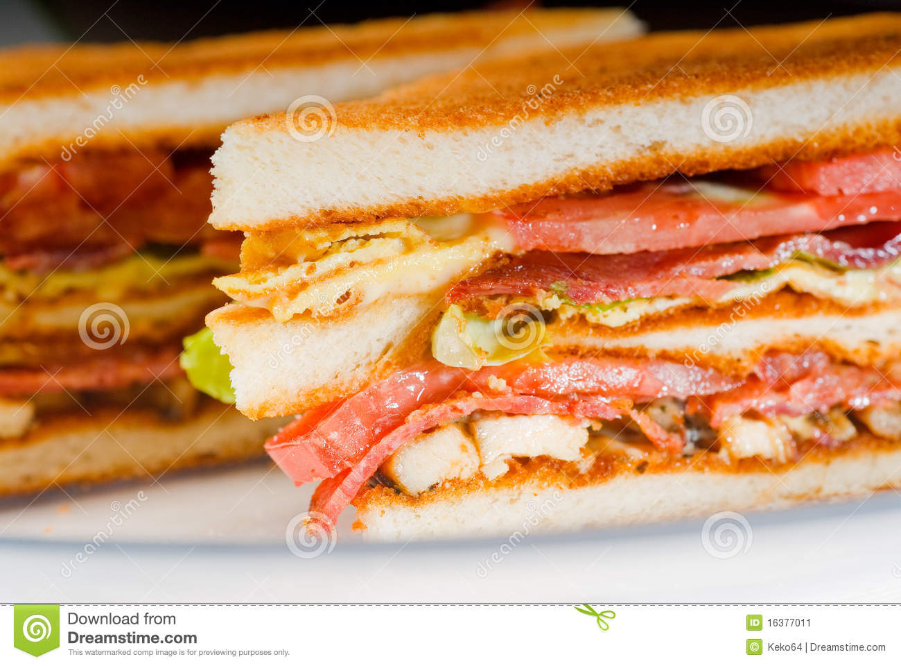 Fresh and delicious classic club sandwich over a transparent glass ...