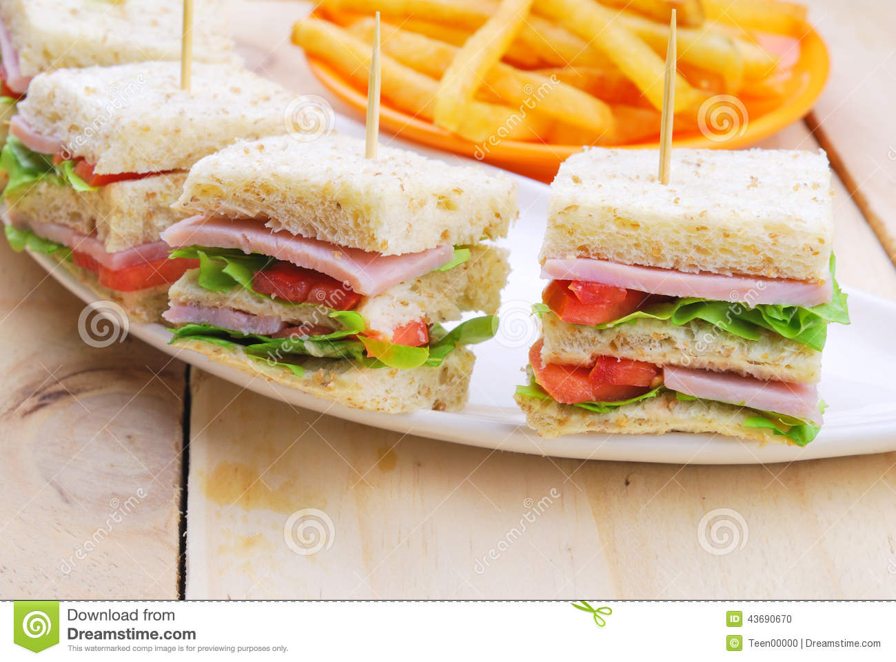 Club Sandwich With Cheese, Pickled Cucumber, Tomato And ...