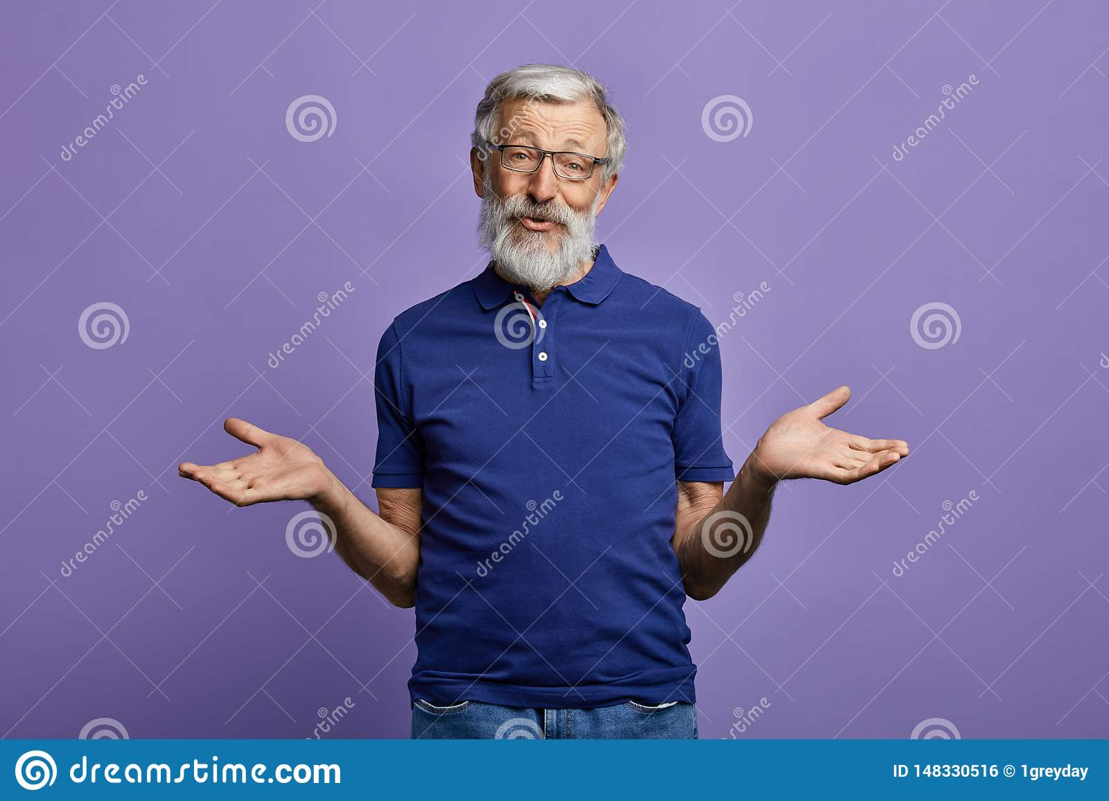 Clueless old man shrugging his shoulders