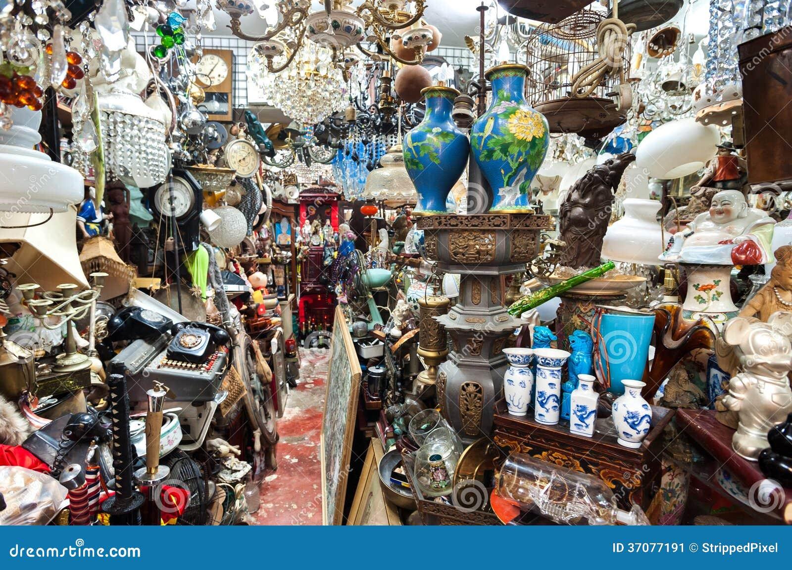 cluttered junk shop at upper lascar row antique market hong kong