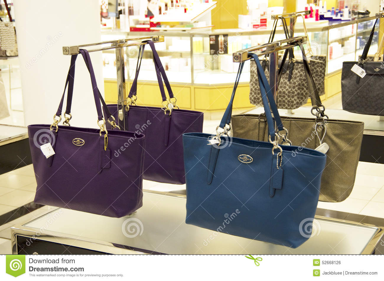 e268460cfb5f Coach handbags and purses were sold in Macy s department store in Seattle.