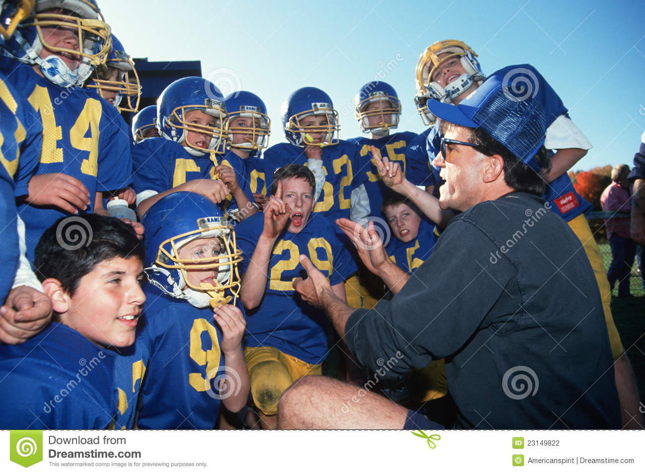 Coach giving youth football team a pep talk in Connecticut Youth Football Coach