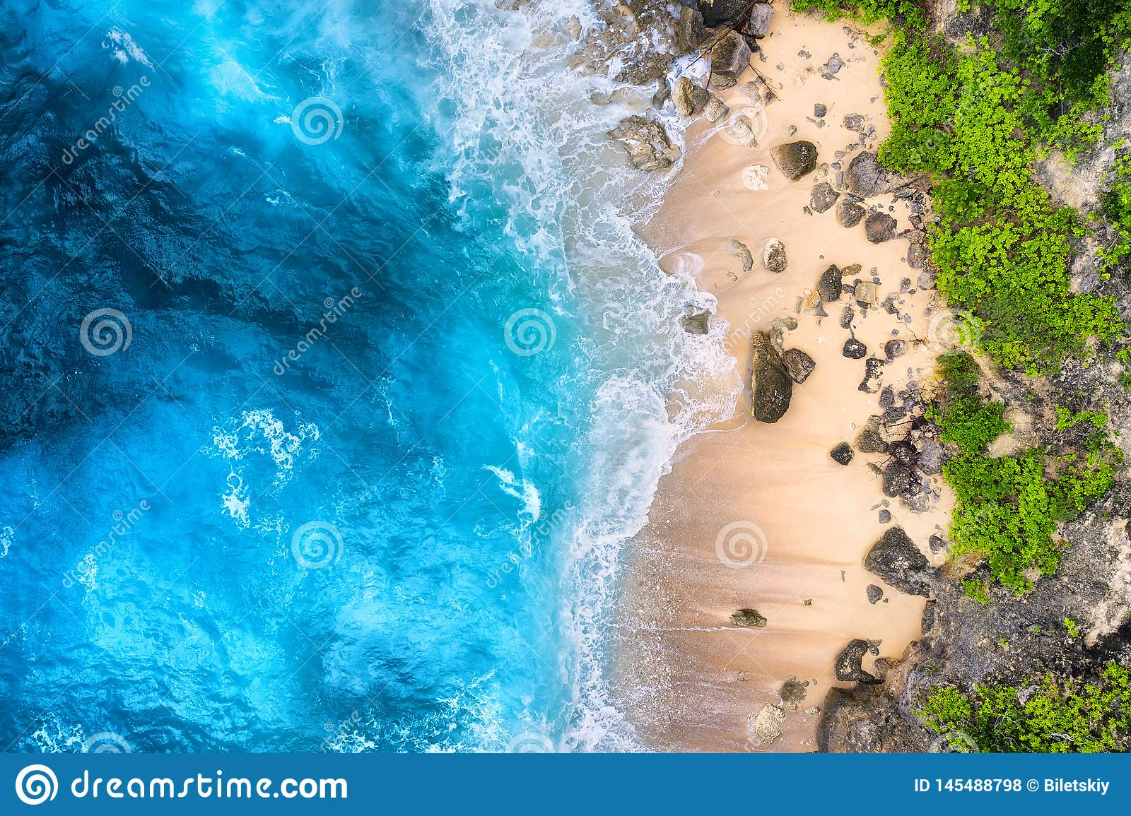 Coast as a background from top view. Turquoise water background from top view. Summer seascape from air. Bali island, Indonesia.
