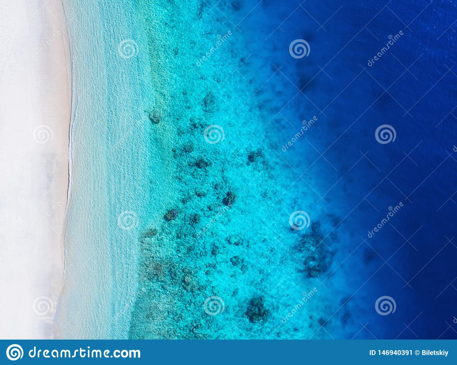 Coast as a background from top view. Turquoise water background from top view. Summer seascape from air.