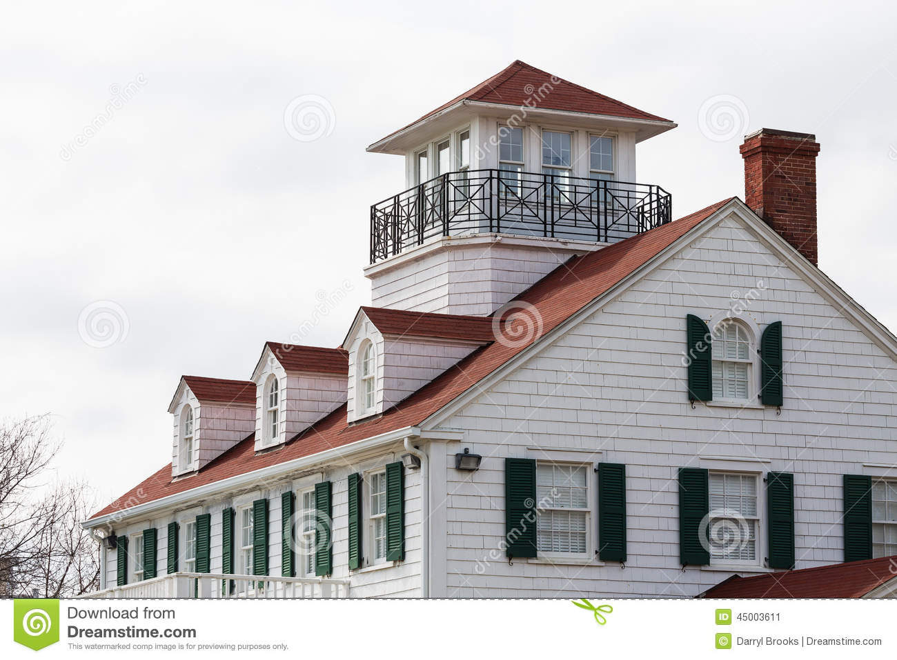 Coastal house with dormers and widows walk stock photo for Cupola on house