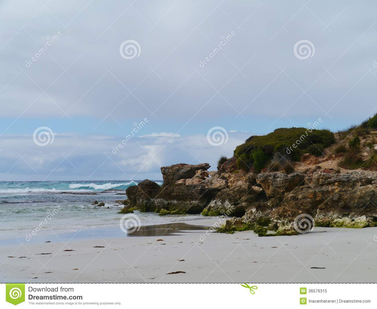 The rocks the beach and the breakers of the Southern ocean at the ...