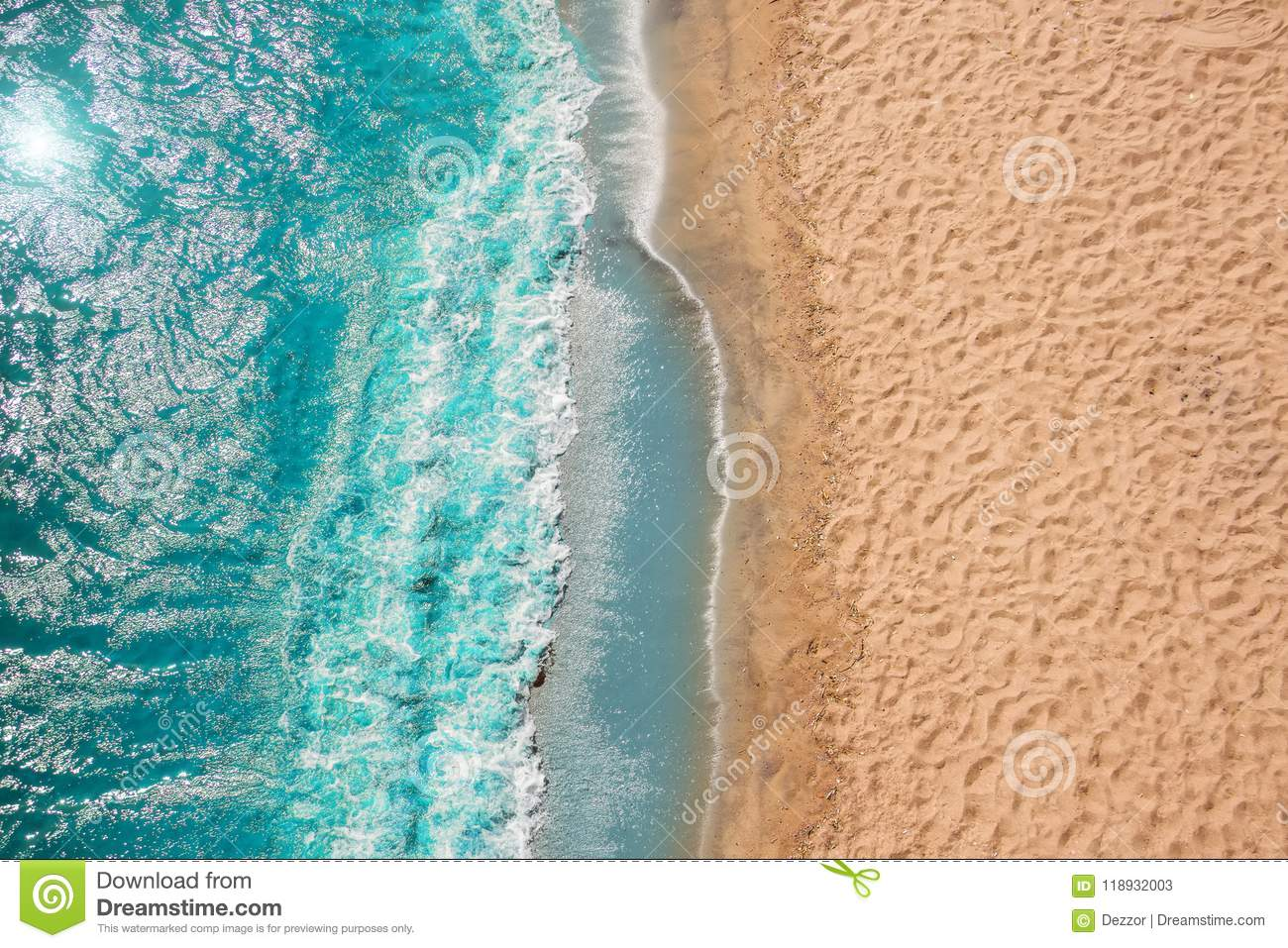Coastline Beach Ocean waves with foam on the sand. Top view from drone.