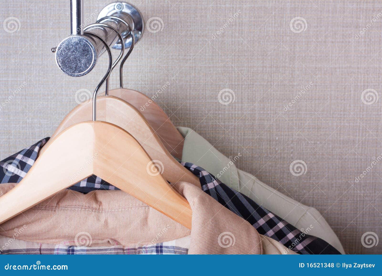 Coat-hangers on rack