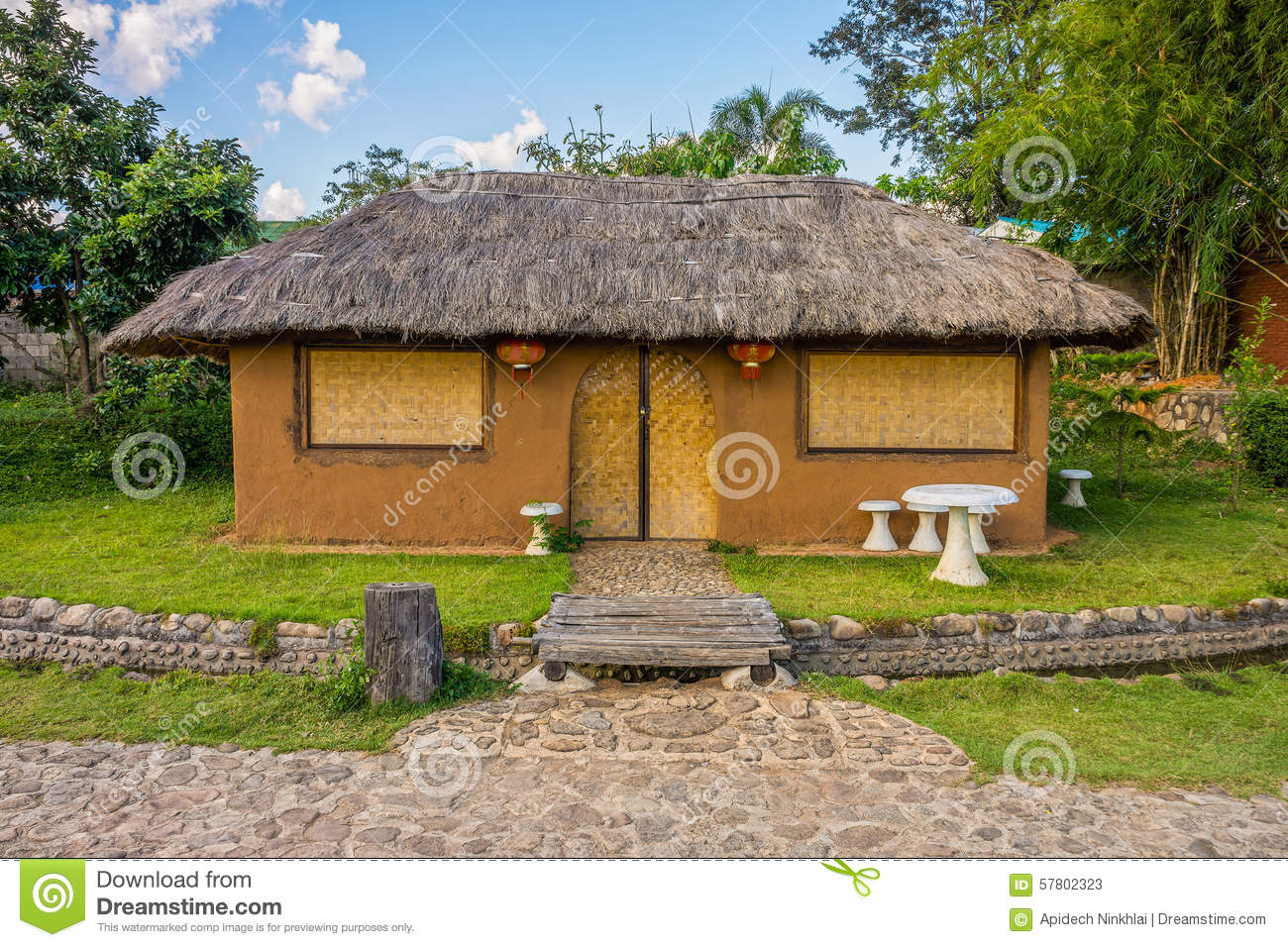 Water Building Material : Cob house with garden in northern thailand stock photo
