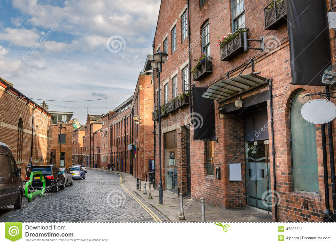 Cobbled Street Lined with Brick Buildings