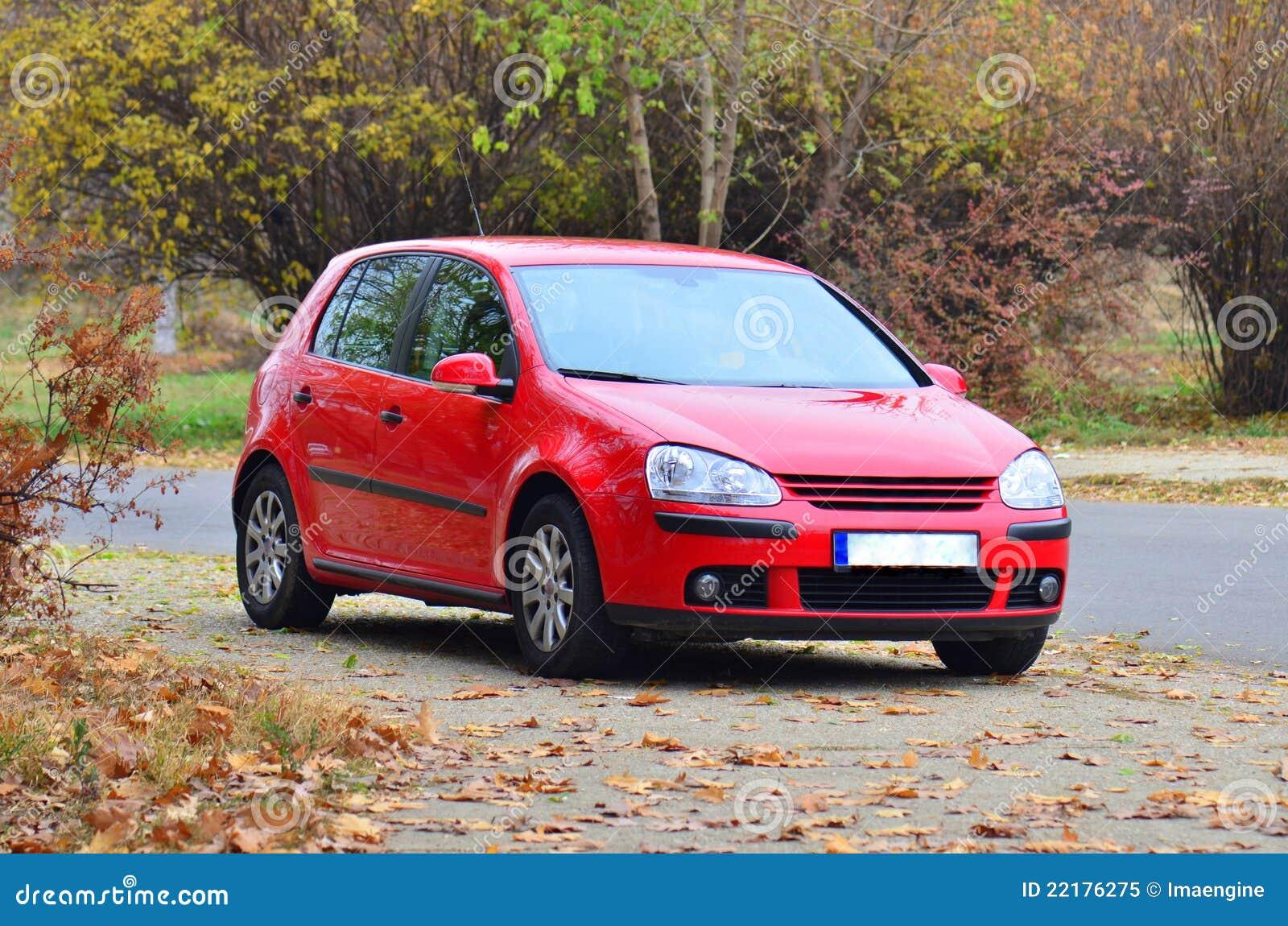 Coche rojo del golf de Volkswagen GTI