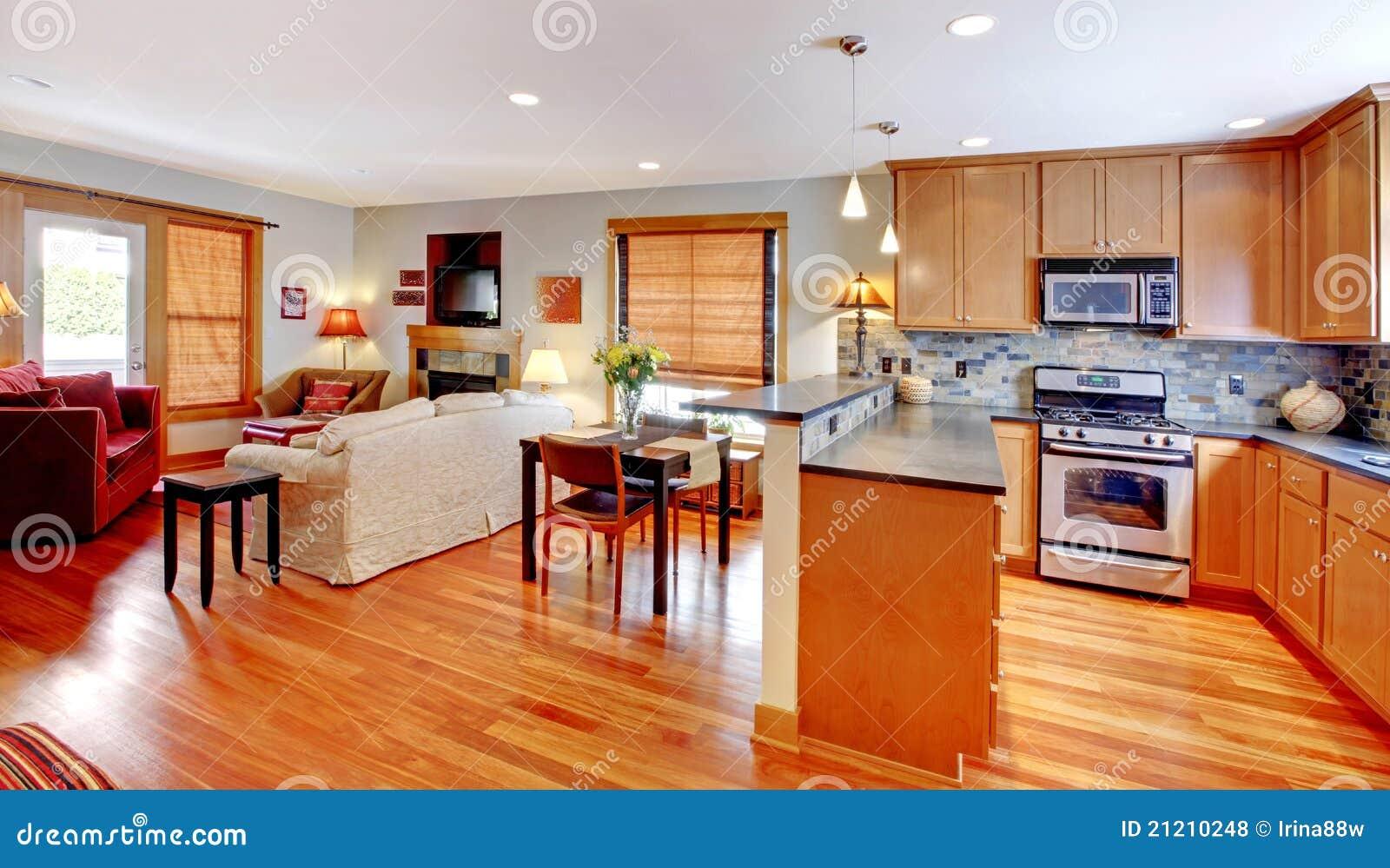 Cocina cena y sala de estar del hogar de la ciudad for Sala de estar estancia cocina abierta
