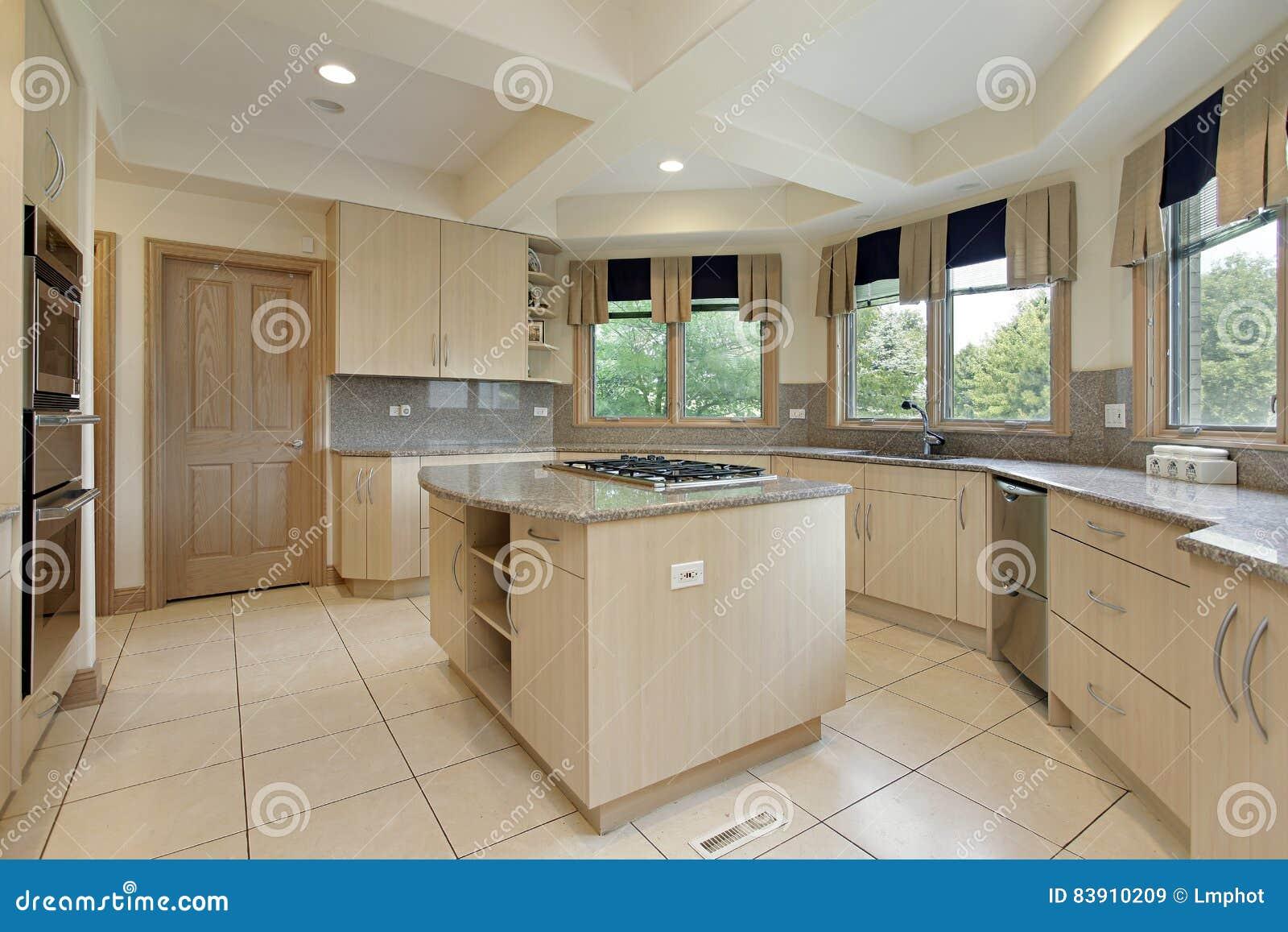 Cocina con la isla del estufa top imagen de archivo for Cocinas con islas en medio