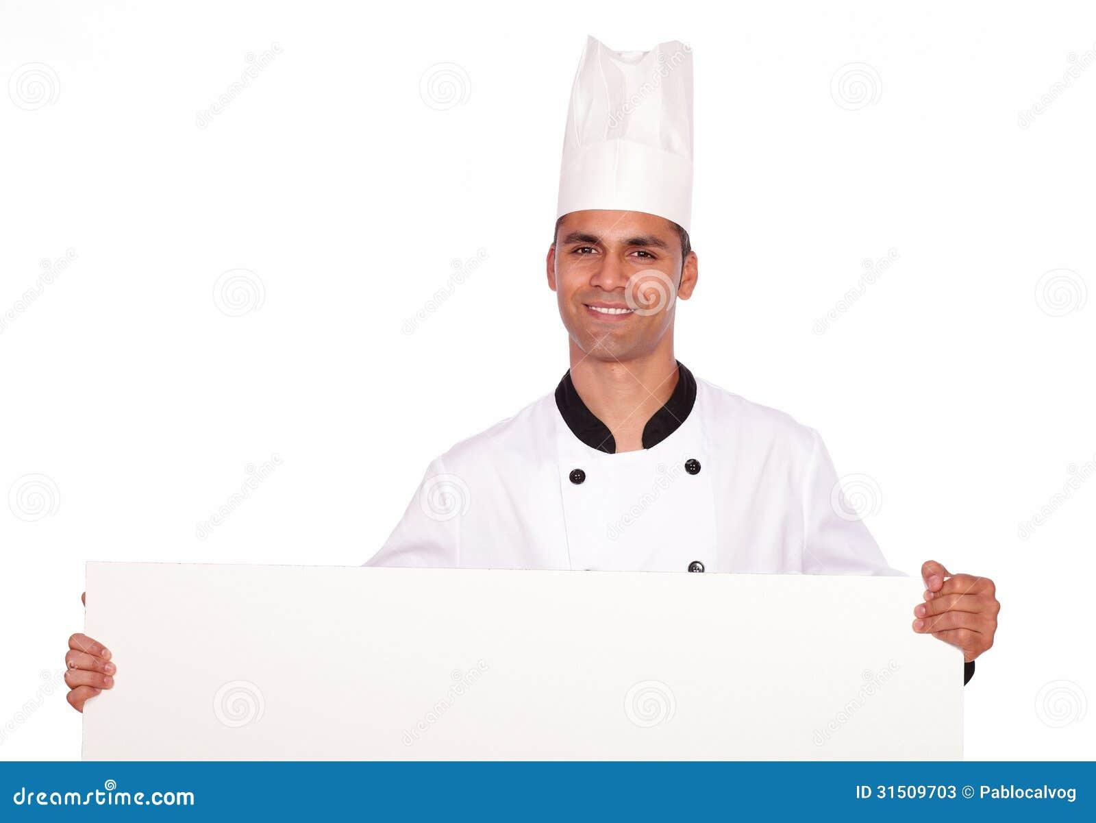 Cocinero encantador del individuo que lleva a cabo un cartel blanco