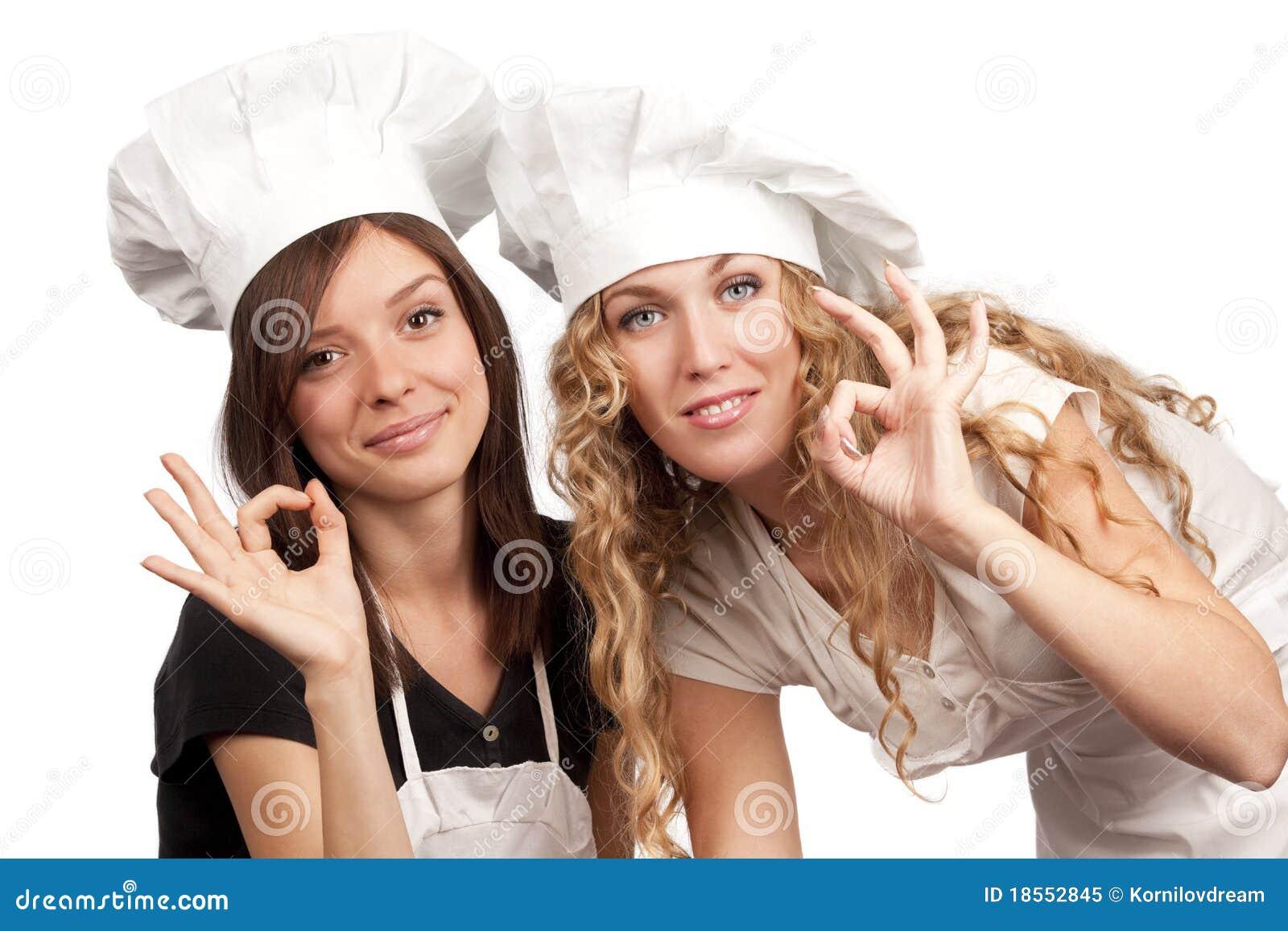 Cocineros de sexo femenino con la muestra aceptable