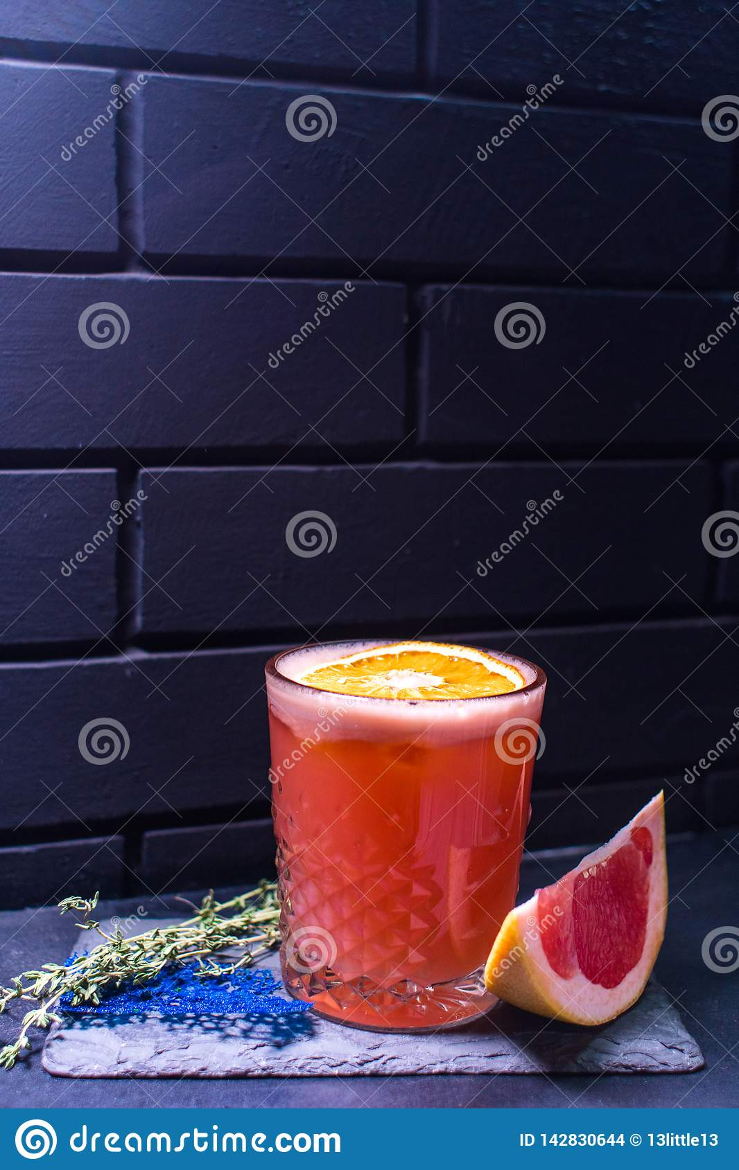 Cocktail against the black brick wall