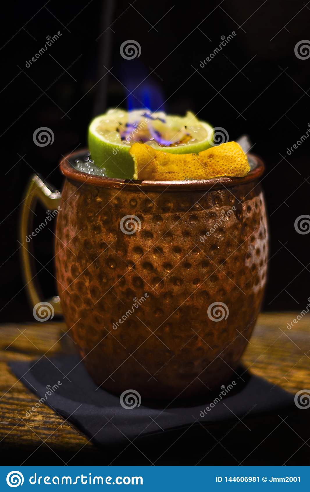 Moscow mule cocktail with flame
