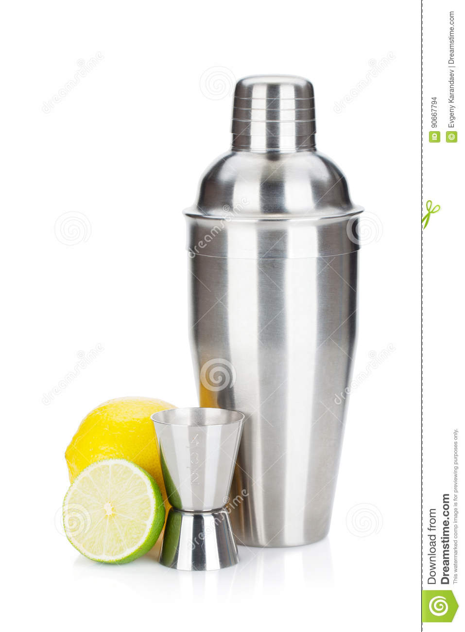 Cocktail shaker with measuring cup and citruses