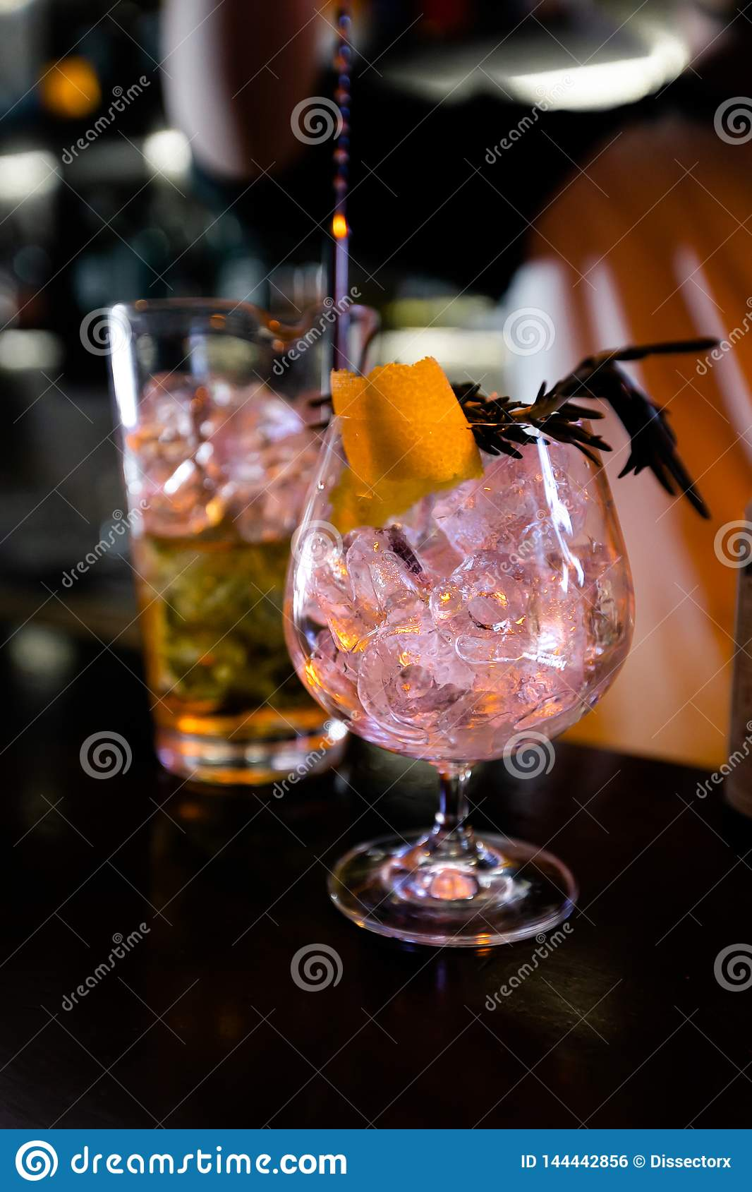 Cocktails by a barmen in a nightclub - Bartender skills are shown