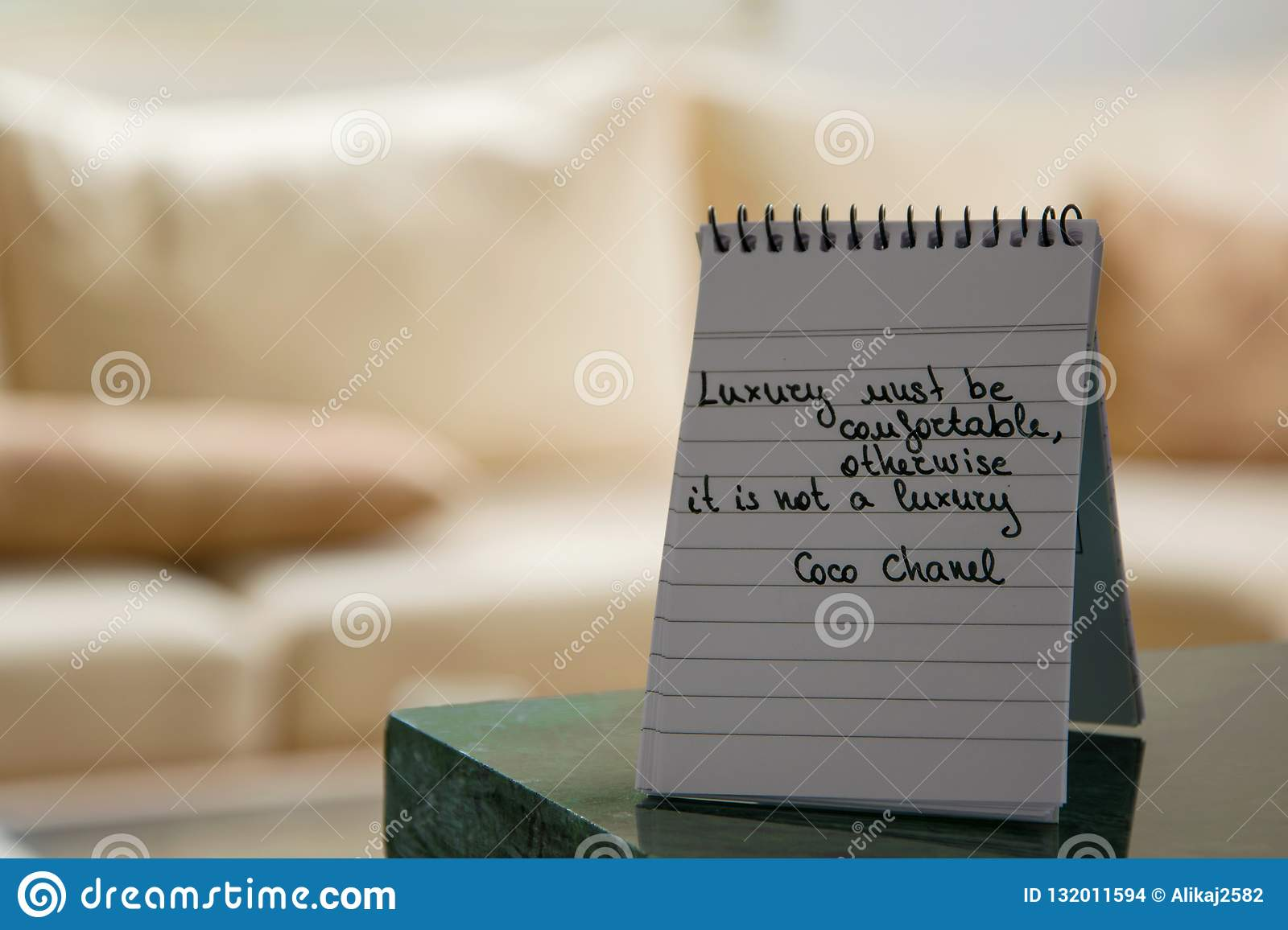 Coco Chanel quotes written on a block note